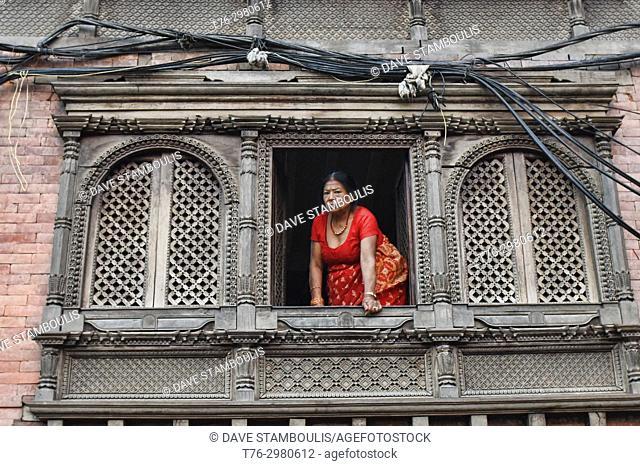 Woman in old Newari home, Swayambhunath, Kathmandu, Nepal