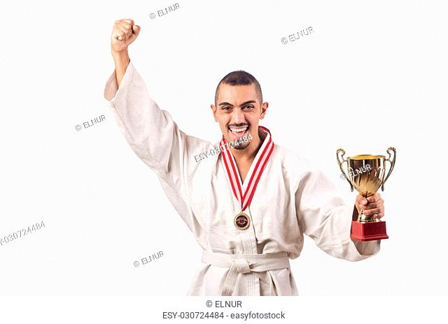 Funny karate fighter with cup on white