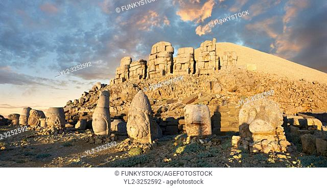 Statue heads at sunset, from right, Lion, Eagle, Herekles, Apollo, Zeus, Commagene, Antiochus, & Eagle, with headless seated statues in front of the stone...