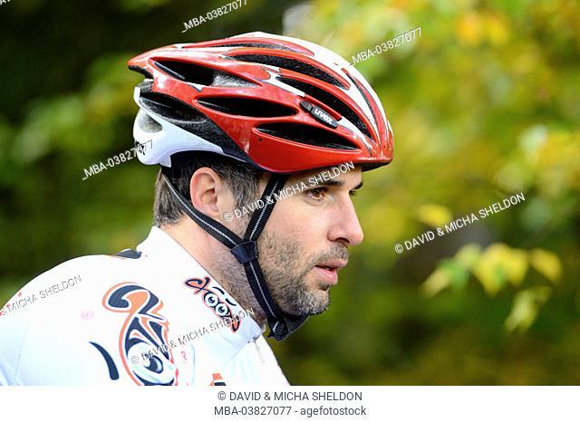 Man with bike helmet, portrait
