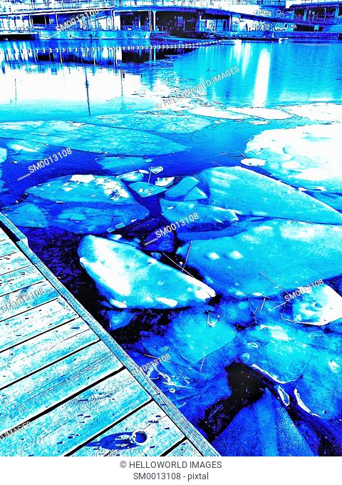 Ice floating by urban waterfront, Stockholm, Sweden, Scandinavia