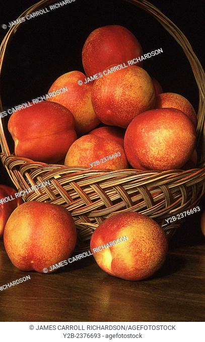 Nectarines in a fruit basket