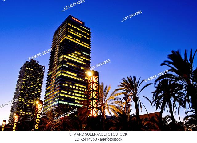 Mapfre tower and Arts Hotel at dusk. Barcelona, Catalonia, Spain