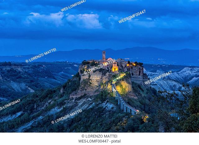 Italy, Lazio, view to Civita di Bagnoregio at blue hour