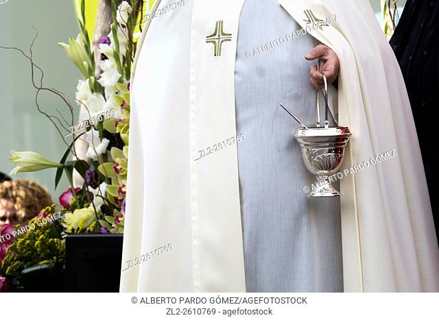 Robed priest and holy water, valencia, Spain