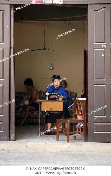 Woman Sewing, Market Rongjiang, Rongjiang, Guizhou, China