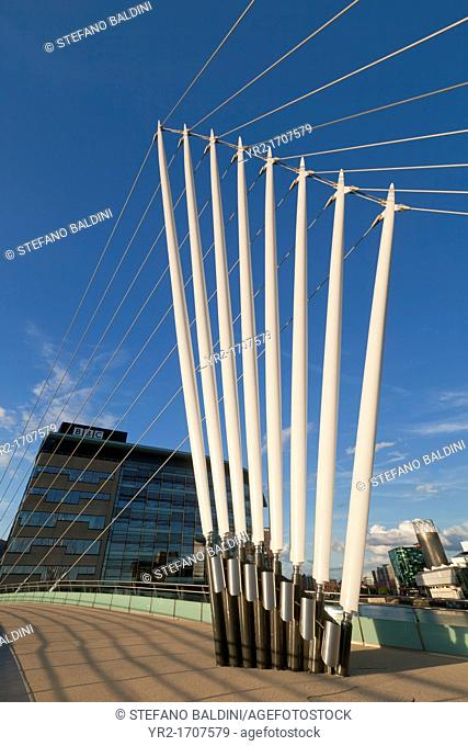 Pedestrian suspension bridge connecting Trafford Promenade with MediaCityUK, Salford Quays, Manchester, UK