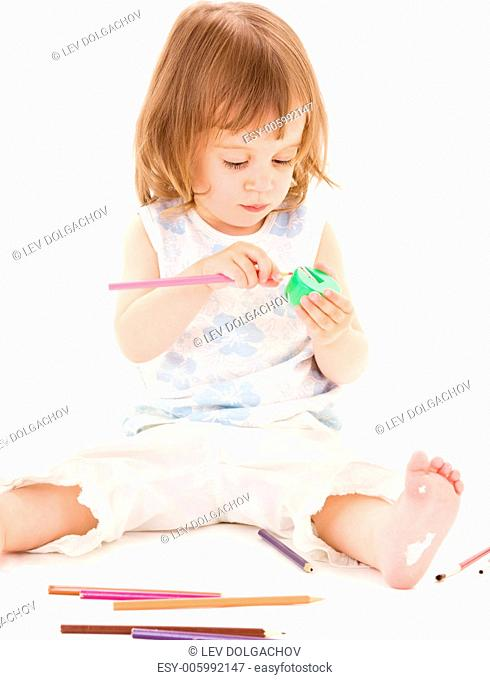 picture of little girl with color pencils over white