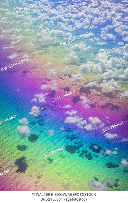 U. S. Virgin Islands, St. Thomas, aerial view of clouds and rainbow over the Caribbean Sea
