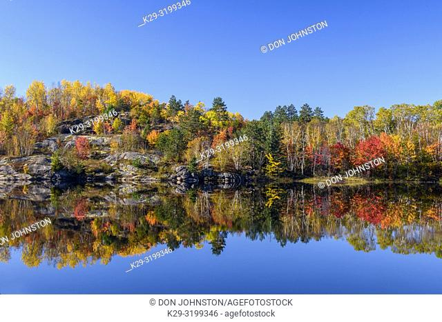Autumn reflections in Elbow Lake, Greater Sudbury, Ontario, Canada