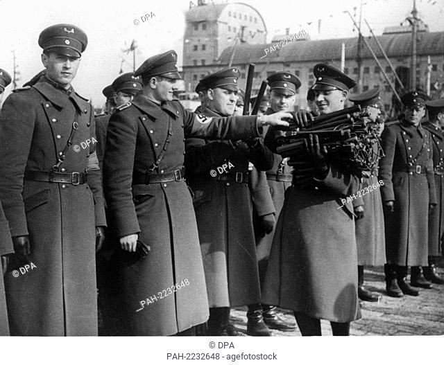 The police in Memel hands over their batons at Reichsführer of the SS Heinrich Himmler's command on the 24th of March in 1939