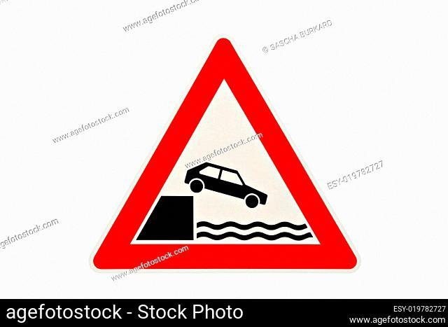 danger sign car falling in water