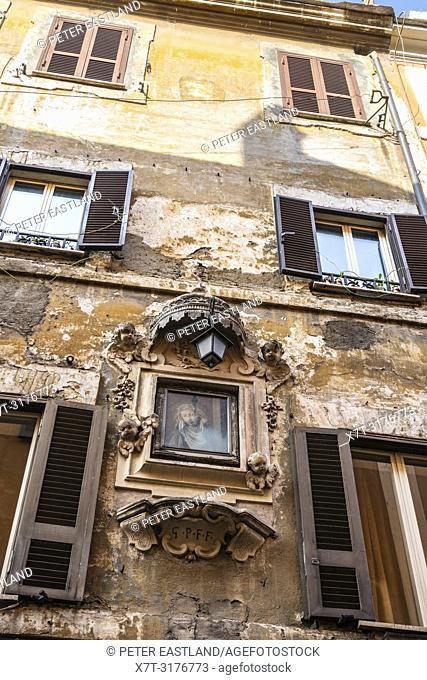 A Maddona looks down from the facade of a house in the Trastevere district of Rome, central Italy