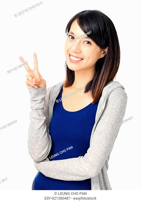 young girl show victory sign isolated on white background