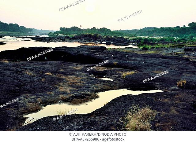 Water puddle on rock, Auranga river, Valsad, Gujarat, India, Asia