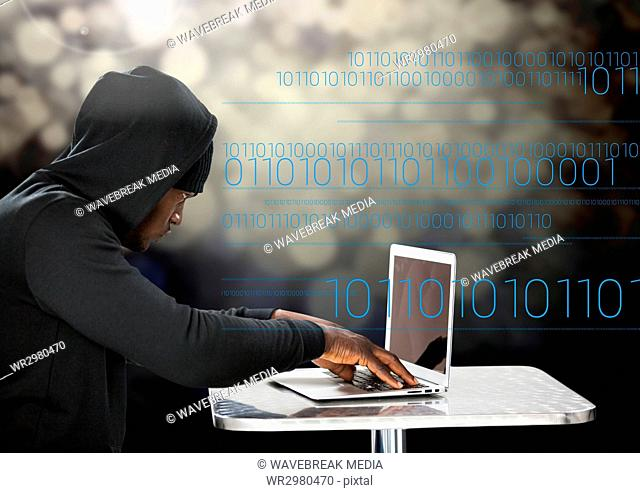 Hacker using a laptop in front of digital background