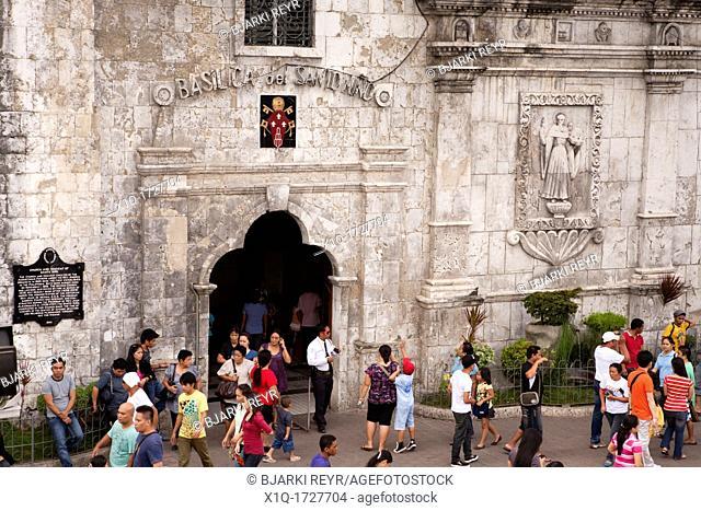 The crowd leaving an outdoor sunday mass at The Minor Basilica of the Santo Nino, aka Basilica Minore del Santo Nino, aka Basilica of Santo Nino  Cebu City