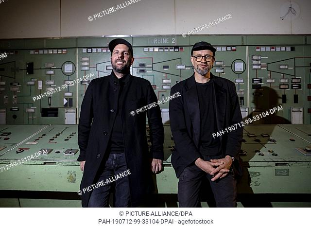 12 July 2019, Berlin: Christopher Bauder (l), light artist, and Robert Henke, composer and musician, are standing in the control room of their audiovisual...