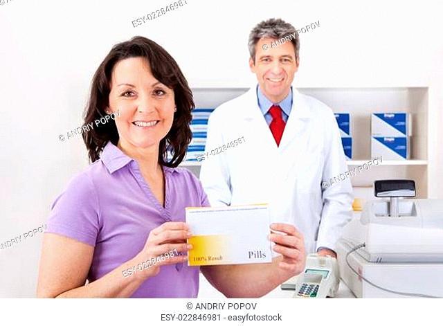 Woman buying medicine at drug store
