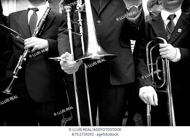 Group of unrecognizable musicians with a clarinet and a trombone performing in the street during Holy Week celebrations, Mahon, Menorca, Baleares, Spain