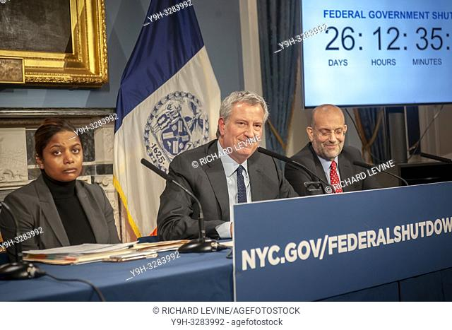New York Mayor Bill de Blasio, center, with Steven A. Banks, New York City Human Resources Administration/Department of Social Services, right