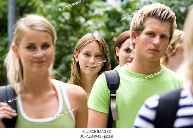 Group of teenage students smiling outdoors