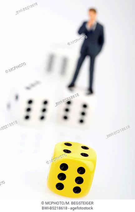 businessman and cubes, symbolic for success