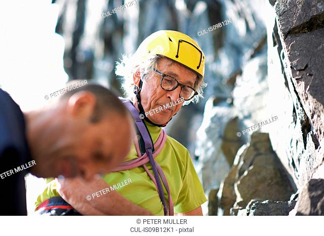 Rock climber wearing climbing helmet