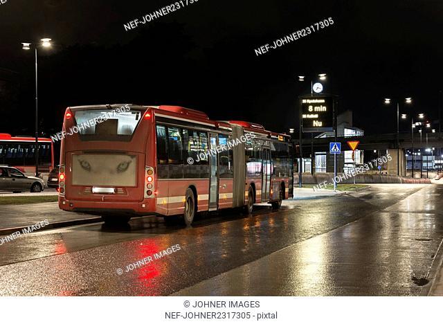 Bus on street at night