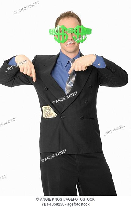 Man with dollar sign glasses and money in his pocket