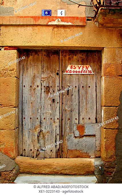 wooden door of building for sale, Linyola, Lleida, Catalonia, Spain