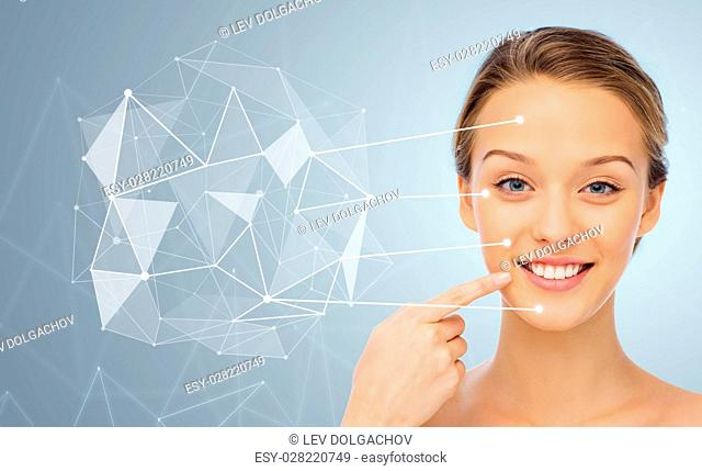 beauty, people and health concept - smiling young woman face and shoulders over gray background with low poly projection and pointers