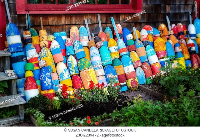 Colorful buoys lined up outside a storefront in Bradley Wharf at Rockport, Massachusetts