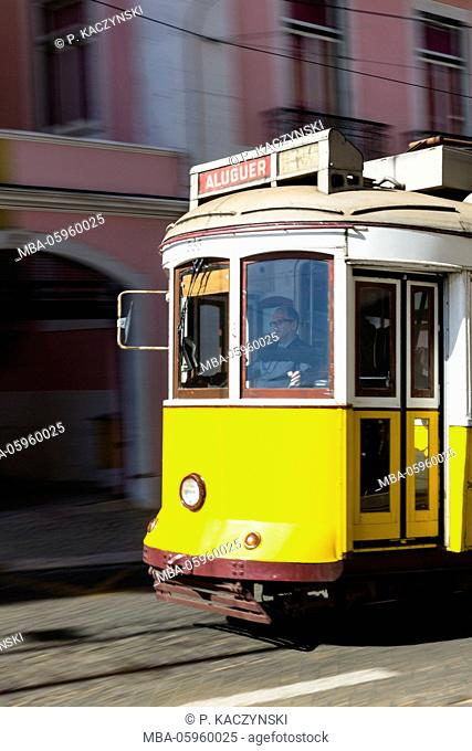 Old tram makes his way through the streets of the Baixa district, blurred motion