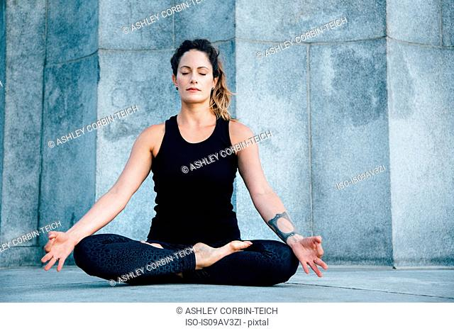 Woman in Easy Seat pose (Sukhasana)