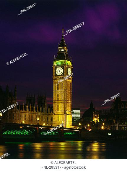 Bell tower lit up at night, Westminster Bridge, Big Ben, Thames River, Houses Of Parliament, London, England
