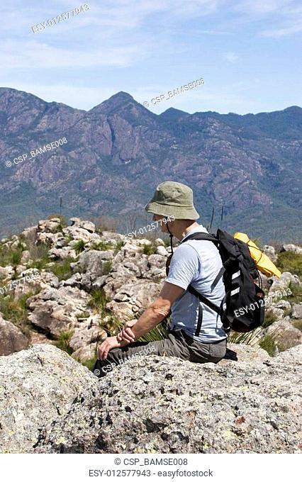 old man sitting on mountain top 2