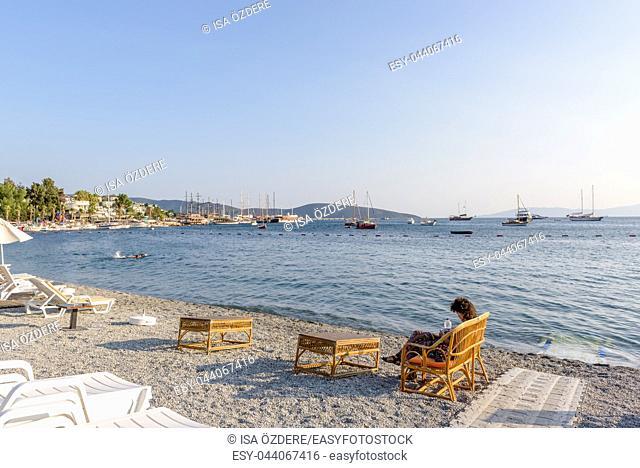 Unidentified people swim and enjoy at beach in Bodrum, Turkey. 23 August 2017