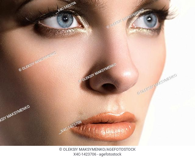Closeup portrait of a beautiful young woman's face