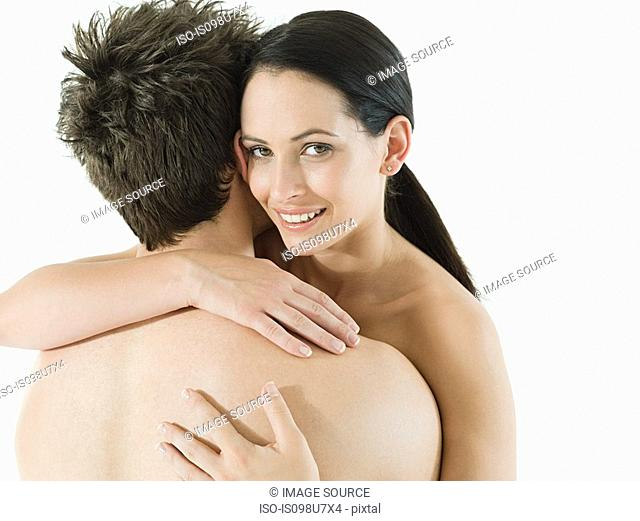 Nude couple embracing