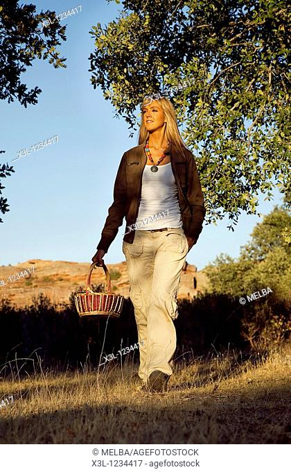 Woman searching mushrooms in Tiermes, Soria  Castile-Leon  Spain