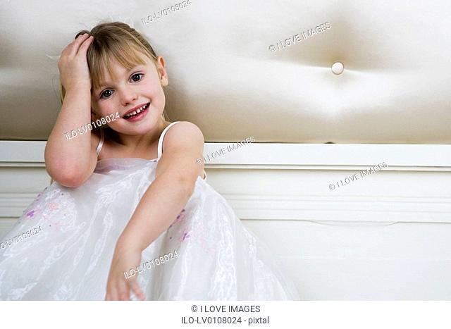 Portrait of a little girl in party dress