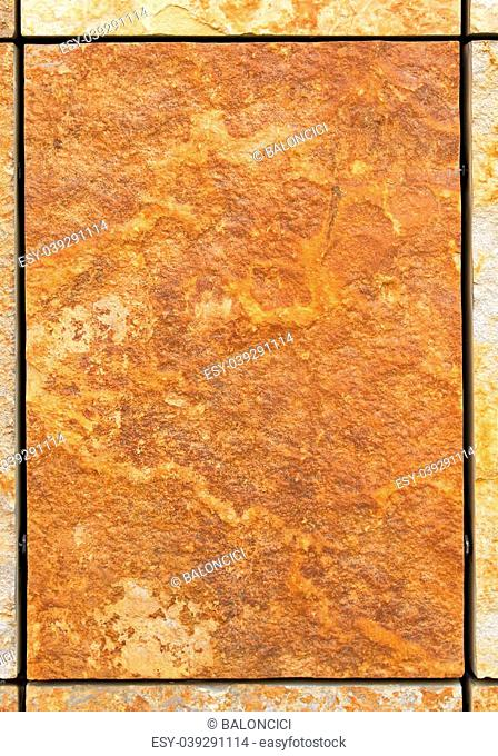Brown marble tile with rough surface area