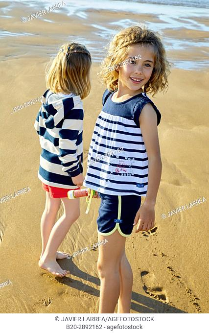 Girls playing on the beach, Zarautz, Gipuzkoa, Basque Country, Spain, Europe