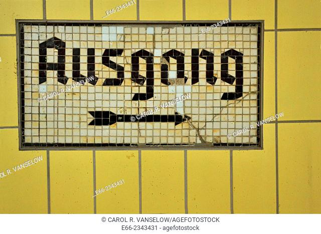 Exit sign in German train station. Sign made of glass tiles