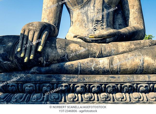 Asia. Thailand, old capital of Siam. Sukhothai archaeological Park, classified UNESCO World Heritage. Wat Mahatat. Buddha statue.Detail