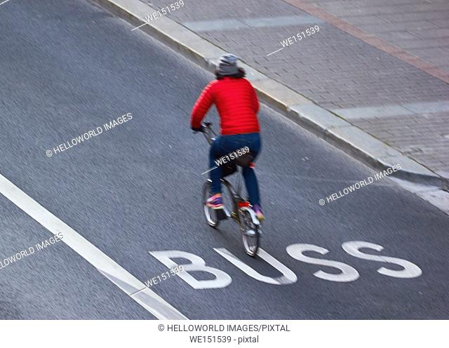 Motion blur of cyclist in bus lane, Stockholm, Sweden, Scandinavia
