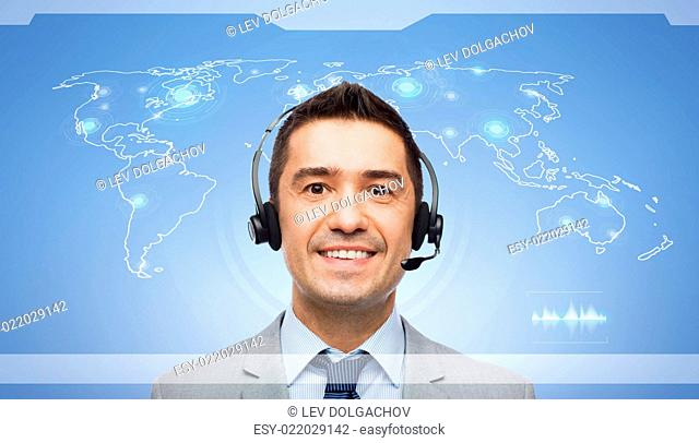 business, people, internet technology, communication and network concept - smiling businessman in headset and virtual screen with world map interface over blue...