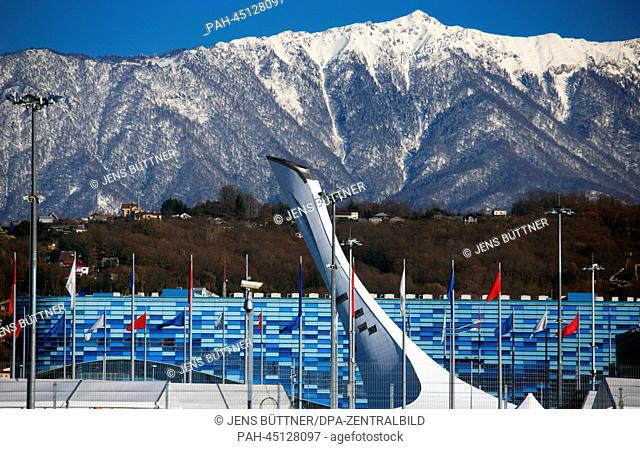 The 'Medal Plaza' and the tower for the Olympic Fire at the Olympic Park Olympic stadium 'Fisht' is photographed against the snow covered Caucasus Mountains in...
