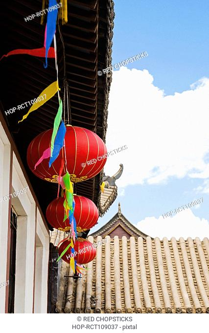 Low angle view of Chinese lanterns hanging on a building, HohHot, Inner Mongolia, China